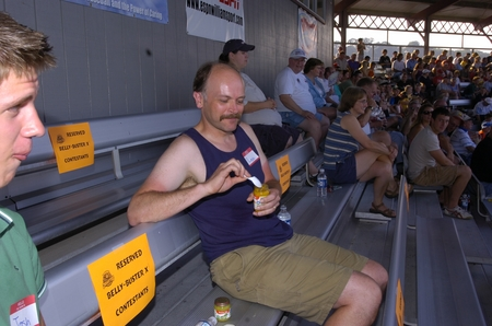Williamsport -- Belly Buster, purple shirt eats from a jar.JPG