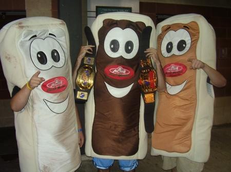Akron - Three Cream Sticks, Two Title Belts.JPG