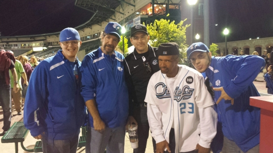 """Jared Wicks, center, dressed as an umpire. Lloyd """"The Suspect"""" Broadnax is in the white Chiefs jersey."""