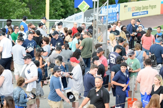 Thousands of Direwolves and Game of Thrones fans line up for a chance to get George RR Martin's autograph prior to the game (Robert M Pimpsner/Pinstriped Prospects)