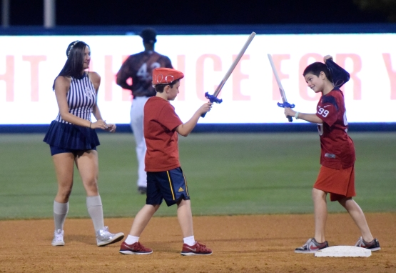 Two young fans duel at second base in the middle of  a Game of Thrones themed costume race around the bases. (Robert M Pimpsner/Pinstriped Prospects)