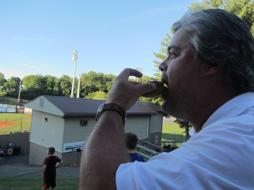 """Todd finishes up his """"very familiar"""" chili dog."""